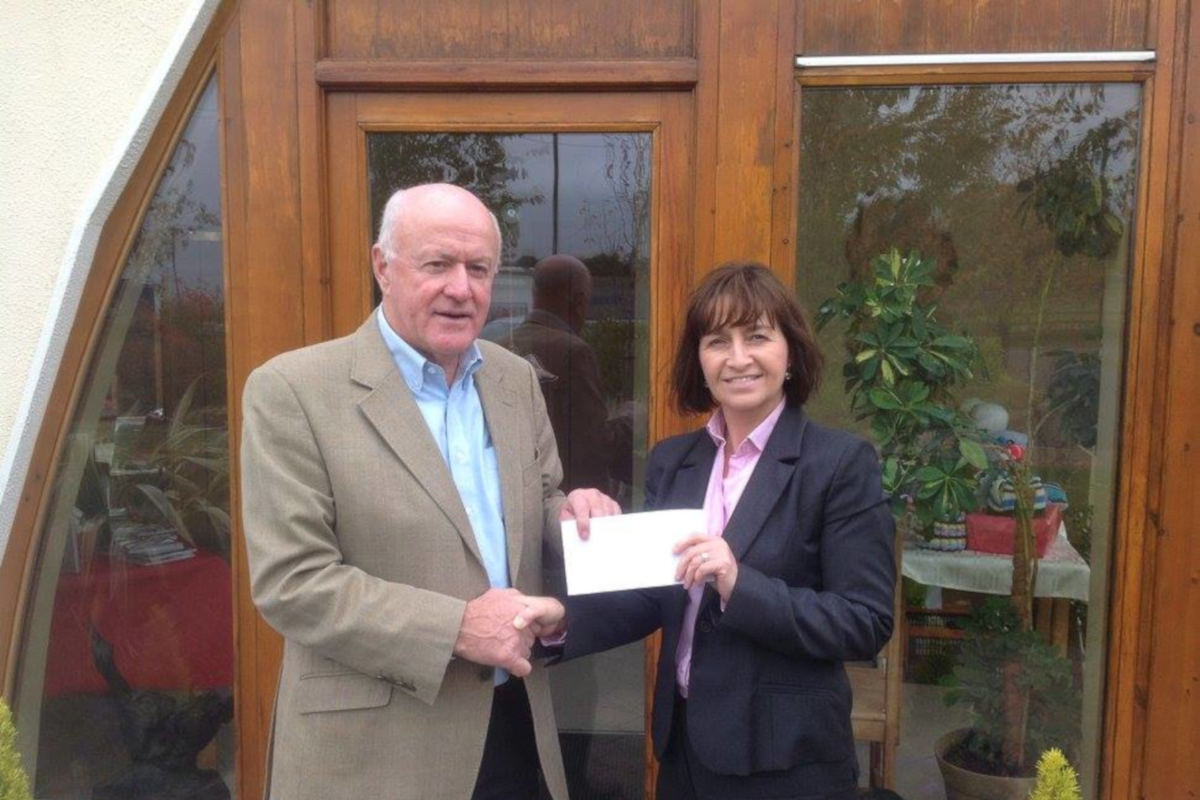 Fundraising Handing Over Cheque Cuisle Cancer Support