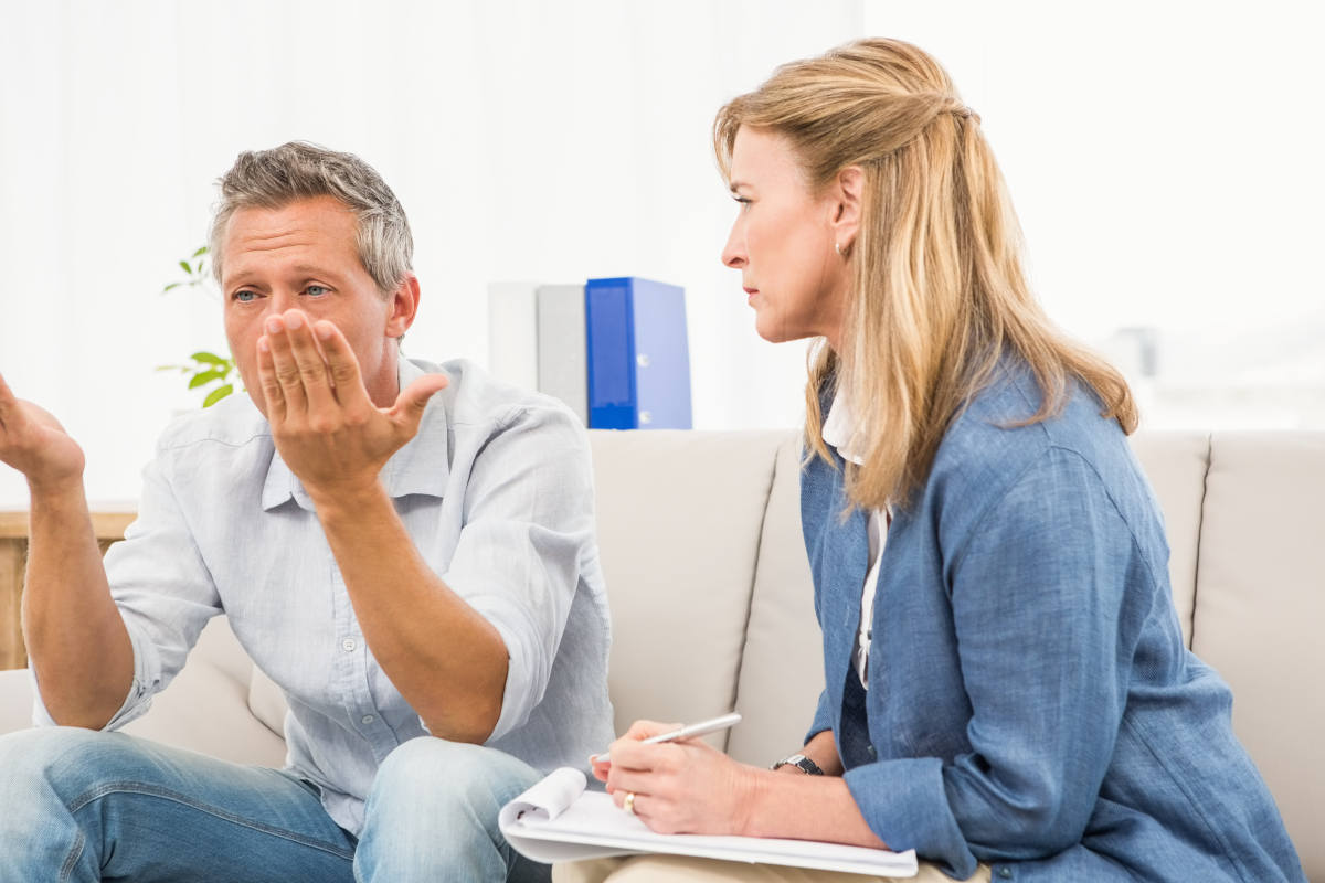 therapist-listening-male-patient Cuisle cancer Support